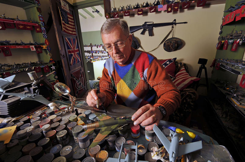 Making aeromodel #10. This man creates hundreds of aircraft and military models for his museum royalty free stock photography