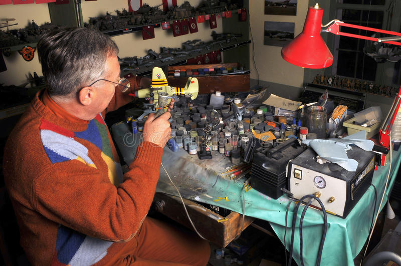 Making aeromodel. This man creates hundreds of aircraft and military models for his museum stock images