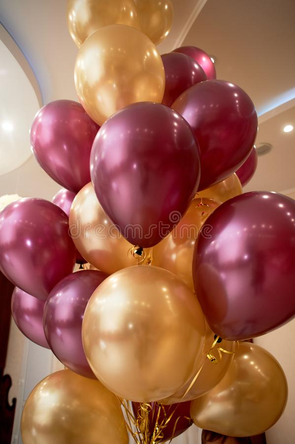 Making balloons gold and purple colors.Children`s birthday, wedding or anniversary stock image