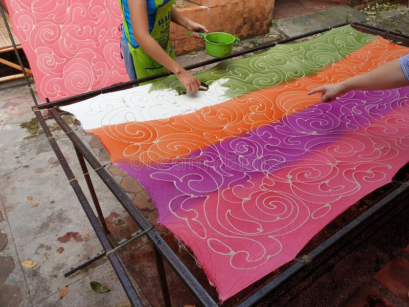Making batik by canting in Thailand. Making batik by canting and painting in Thailand stock photo