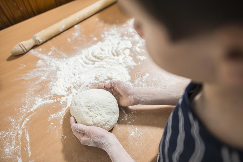 Making bread in a kitchen royalty free stock images