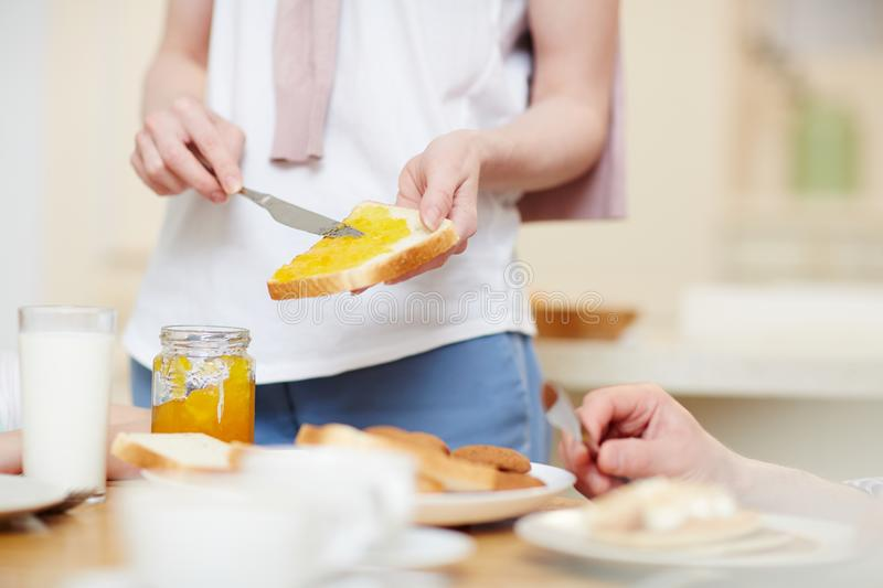 Making bread toast with jam royalty free stock photography