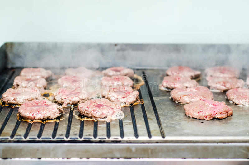 Making burgers royalty free stock images