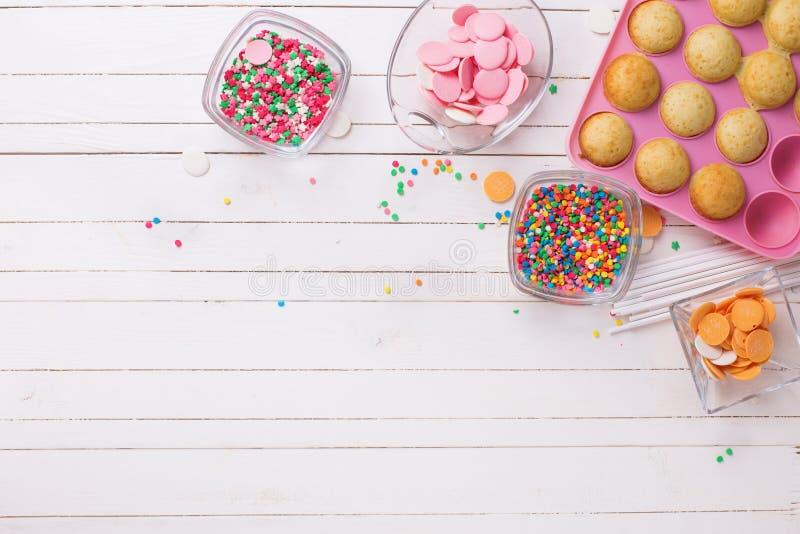 Making cake pops on white wooden background. stock photo