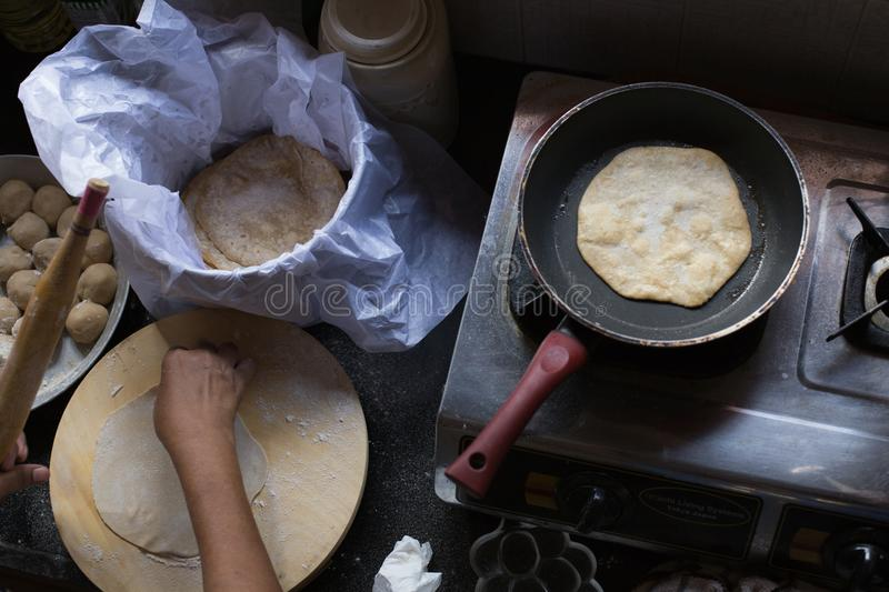 Cooking Chapatti in Goa, India stock images