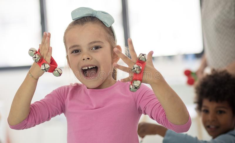 Making cheerful music. Children in preschool royalty free stock image