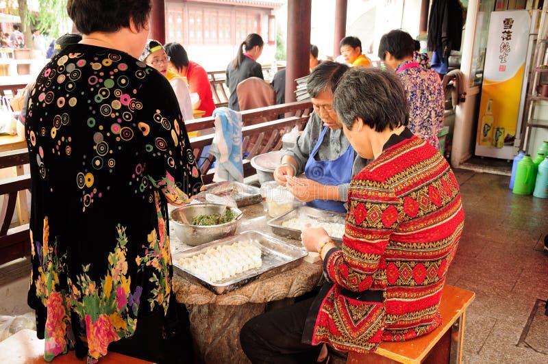 Making Chinese dumplings royalty free stock images