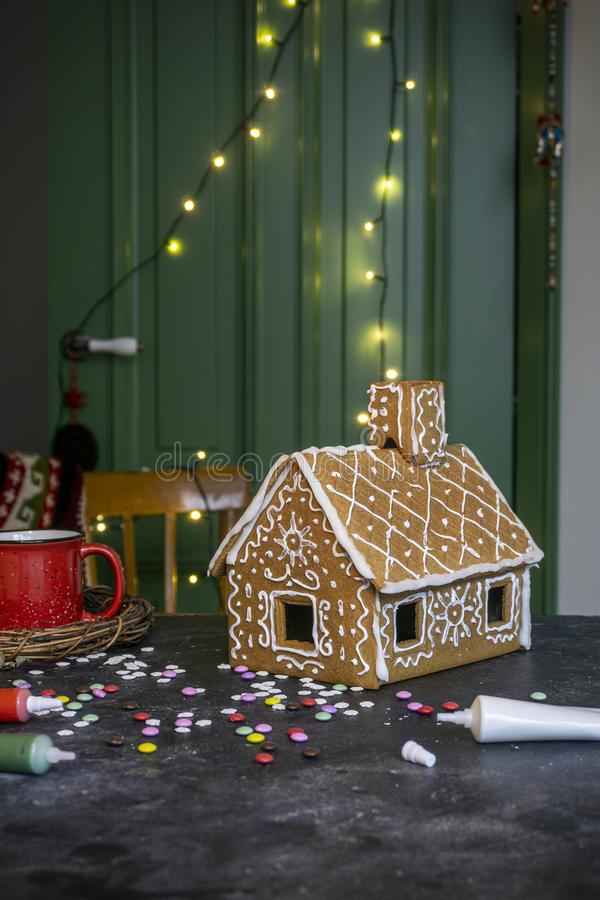 Making Christmas gingerbread house. Traditional Christmas baking and cookies stock photos
