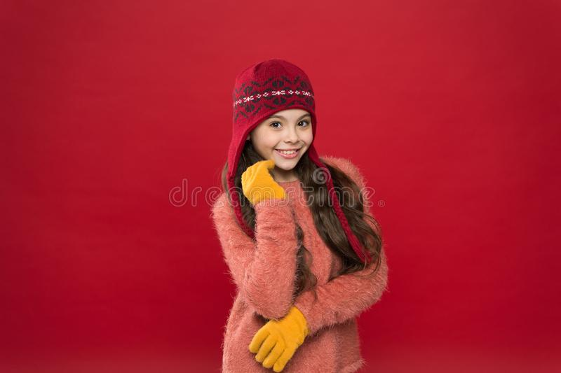 Making christmas wish. Stay warm. Little girl winter fashion accessory. Small child long hair wear hat burgundy stock photo