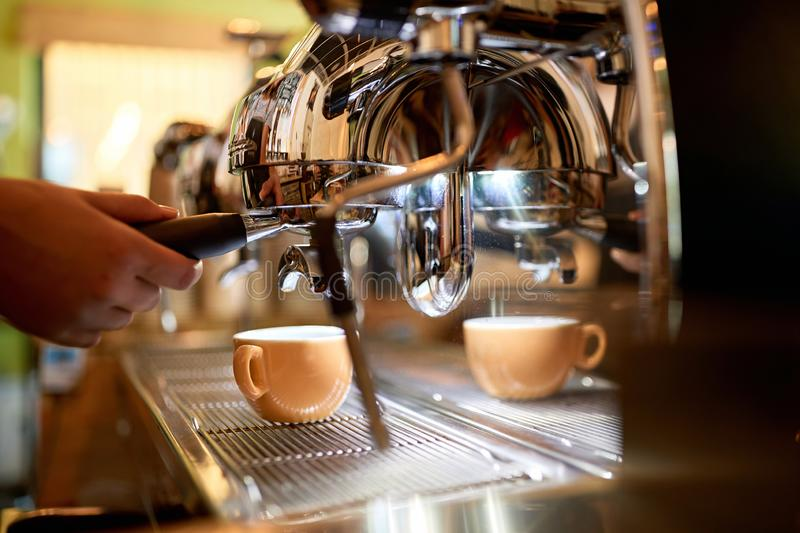 Making coffee on coffee maker machine at cafe store stock photo