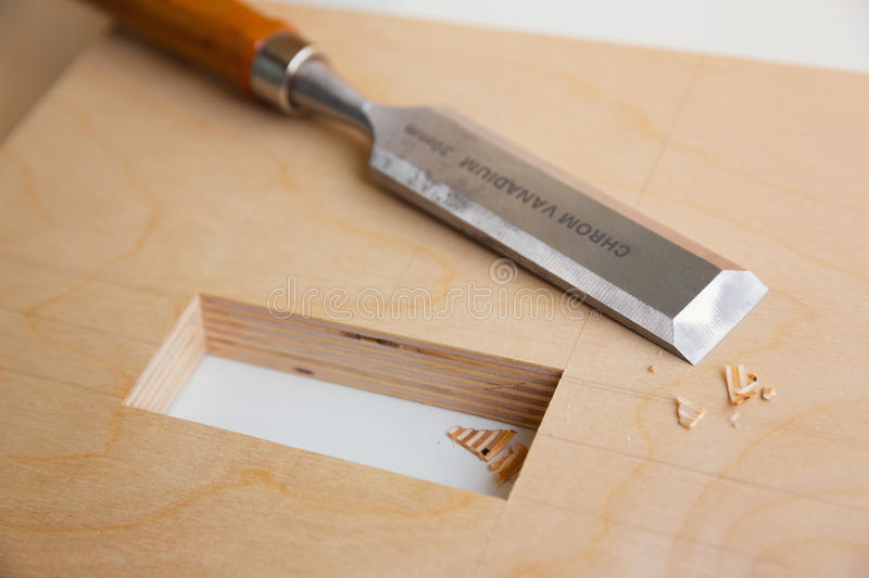 Making a component of wood furniture. Close-up photo stock photos