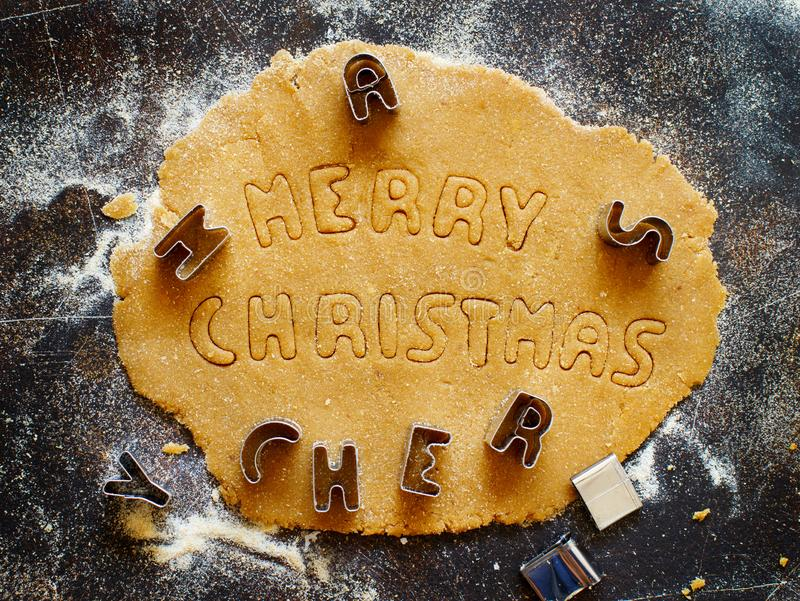 Making cookie words Merry Christmas stock image