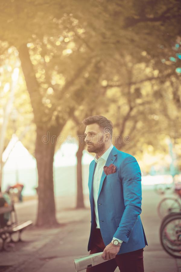 Making the corporate world look good. Business man in the city park stock images
