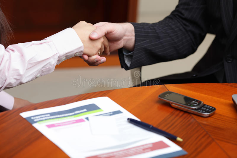 Making a deal. Business man and business woman making a deal royalty free stock photo