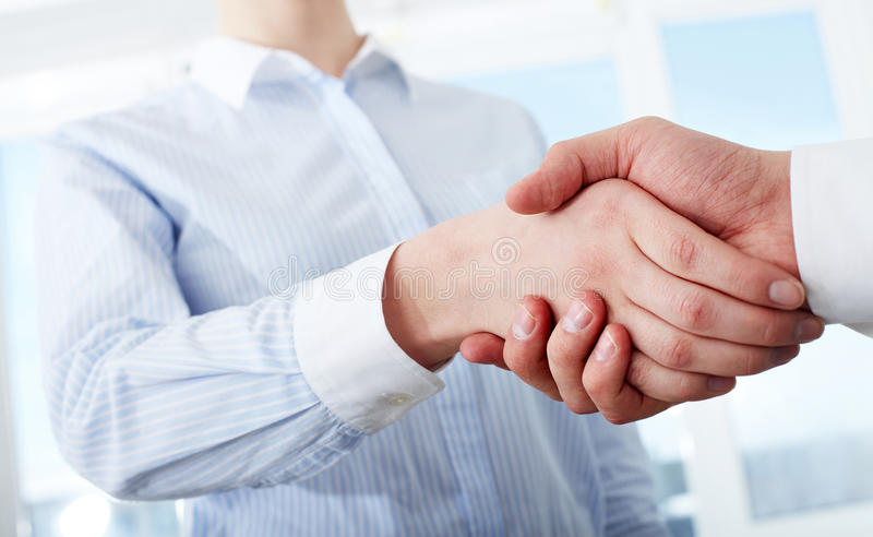 Making deal. Photo of handshake of business partners after striking deal stock photos