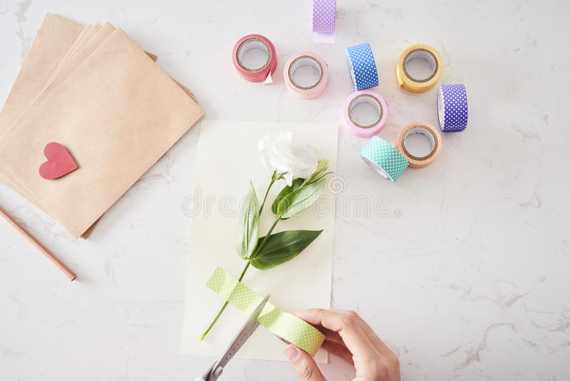 Hands of woman making birthday card, view from the top stock photography