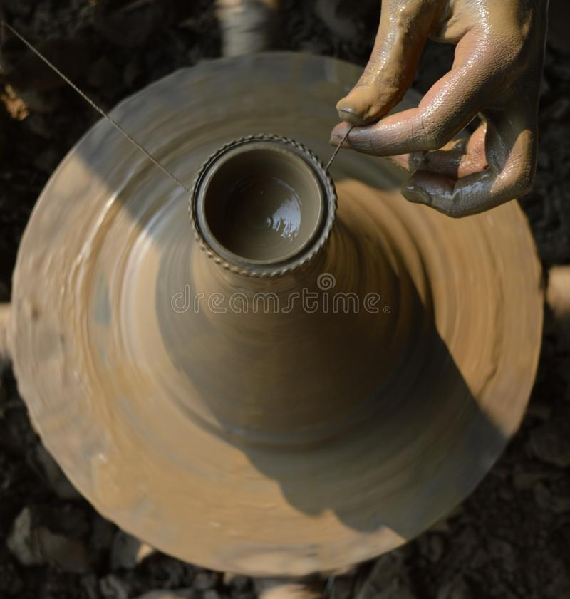 Clay Artist. Making diva for Diwali festival royalty free stock image