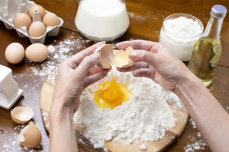 Making dough from eggs and milk. Cooking and home concept.  royalty free stock image