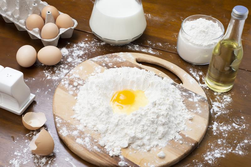 Making dough from eggs and milk. Cooking and home concept.  stock photos