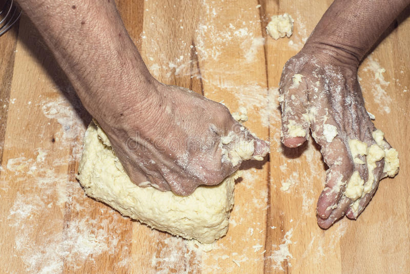 Making dough. Hands making dough with flour in closeup royalty free stock photos