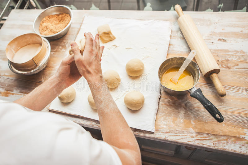 Making dough by male hands. At bakery. Ingredients for cooking flour products or dough (bread, muffins, pie, pizza dough royalty free stock image