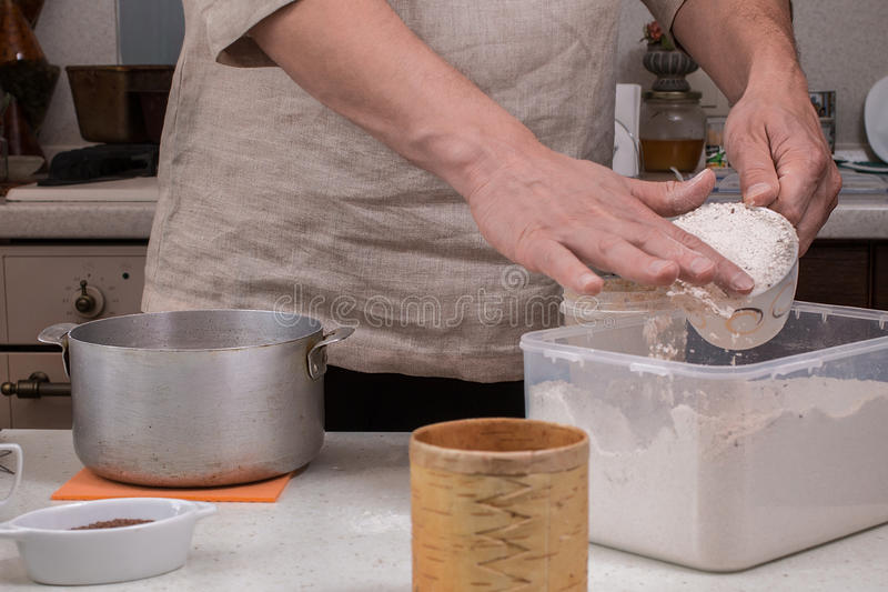 Making dough by male hands at home in kitchen. Homemade bakery, cooking process concept stock image