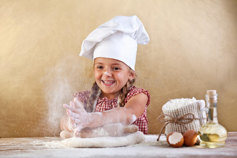 Making the dough for pizza is fun. Little chef playing with flour royalty free stock photos