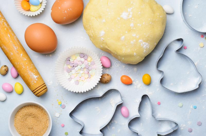Making of Easter Cookies, Baking Background, Dough, Cookie Cutters, Sugar Sprinkles. Making of Easter Cookies, Dough, Cookie Cutters, Sugar Sprinkles, Festive stock image