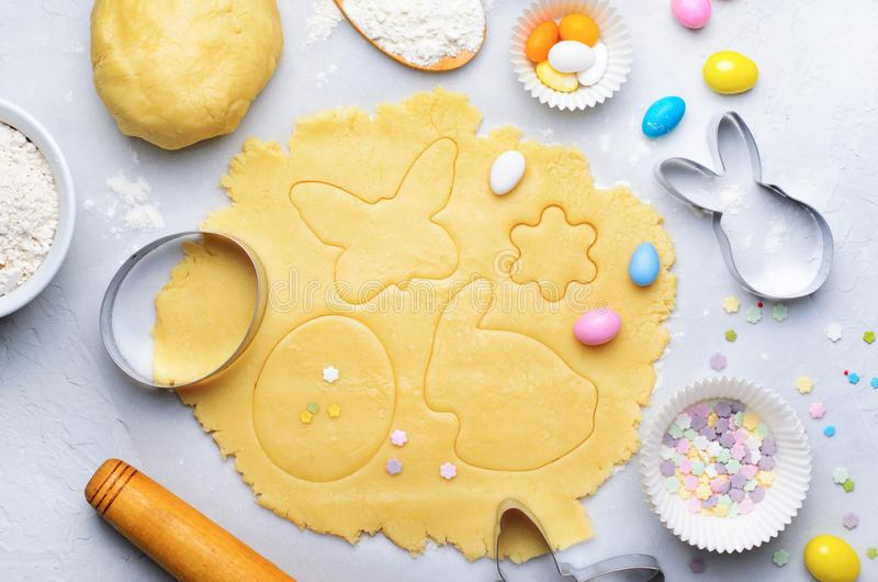 Making of Easter Cookies, Baking Background, Dough, Cookie Cutters, Sugar Sprinkles. Making of Easter Cookies, Dough, Cookie Cutters, Sugar Sprinkles, Festive stock images