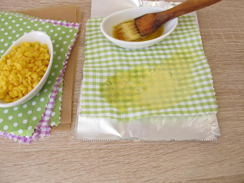 Making of ecological plastic-free beeswax cotton wraps. As an alternative to plastic bags stock image
