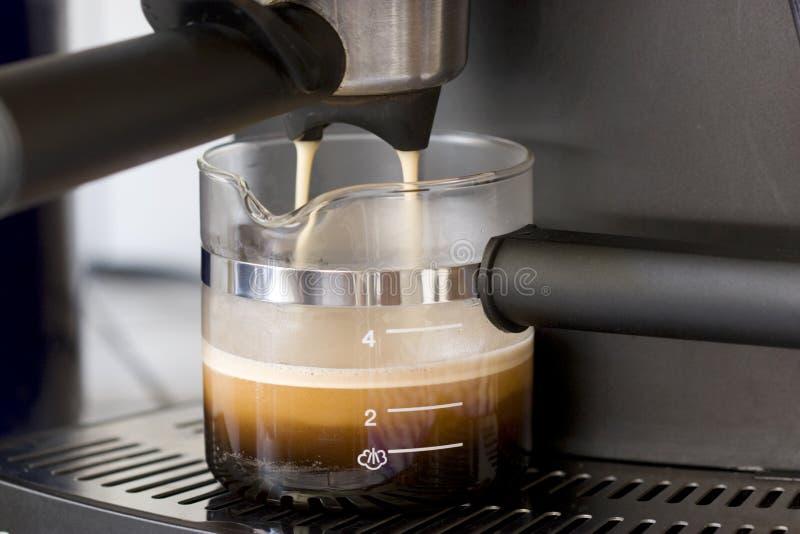 Making Espresso. Home espresso machine brewing espresso stock photos