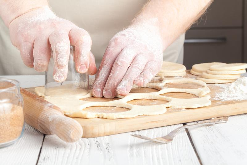 Making festive gingerbread dough on a baking sheet stock photography