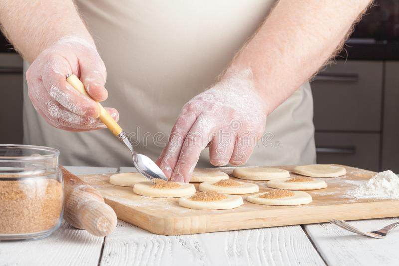 Making festive gingerbread dough on a baking sheet royalty free stock image