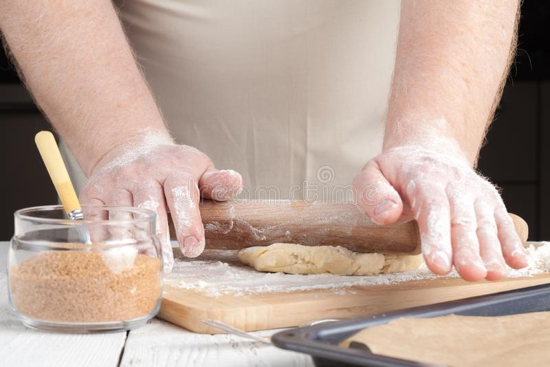 Making festive gingerbread dough on a baking sheet stock image