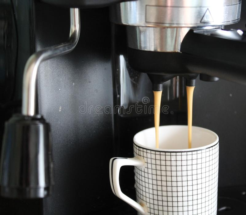 Making an espresso stock image