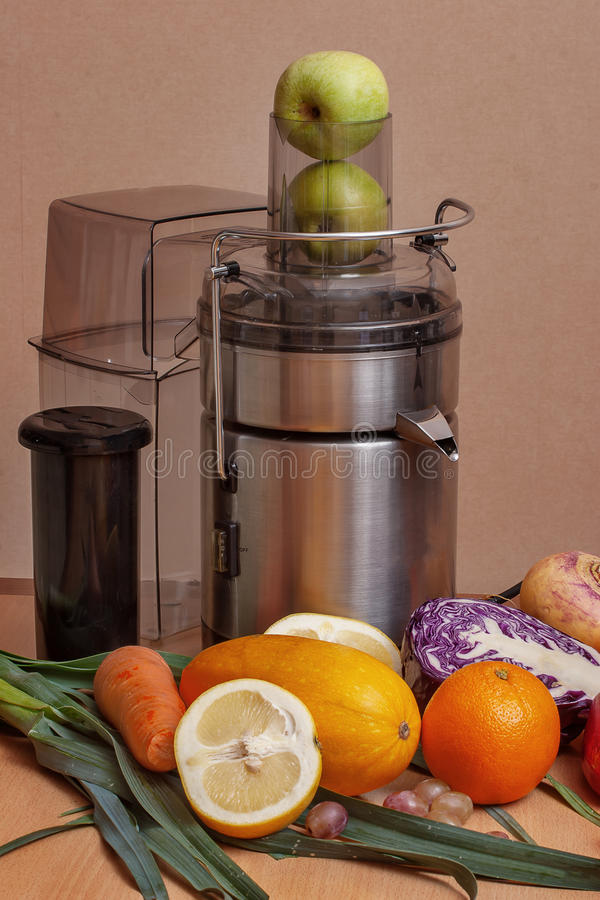 Making fresh juice. From fruits and vegetables royalty free stock image