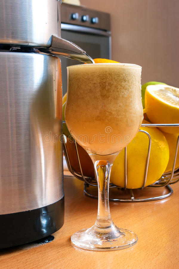 Making fresh juice. From vegetables and fruits royalty free stock photo