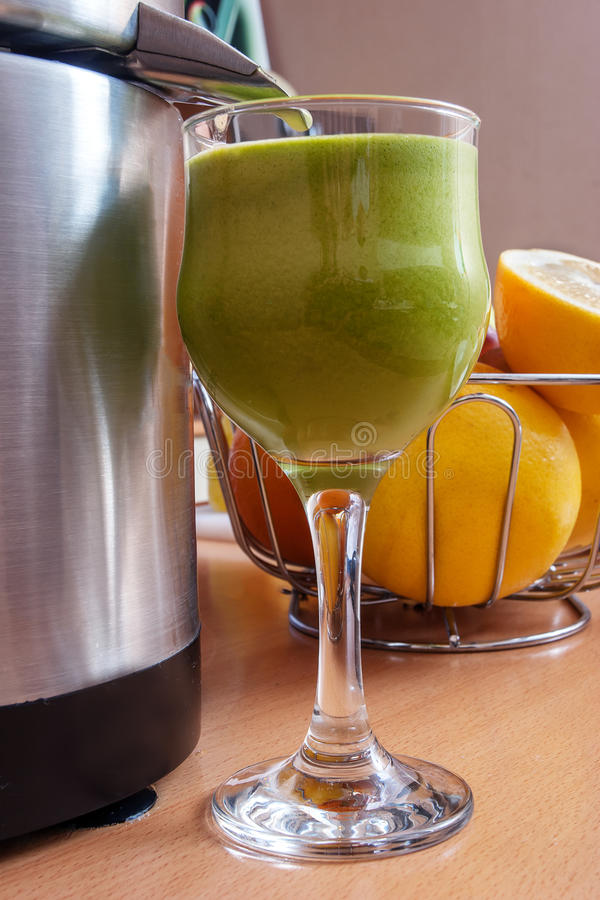 Making fresh juice. From vegetables and fruits royalty free stock images