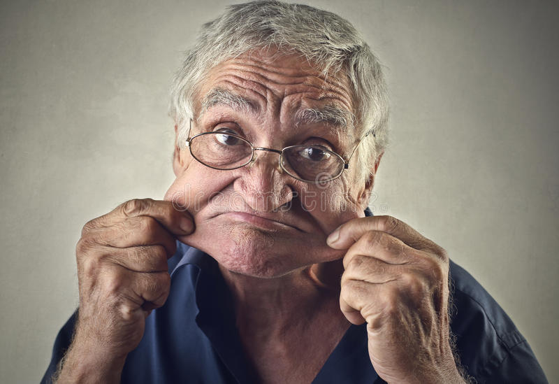 Making funny jokes. Elderly man making funny jokes stock photography