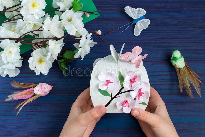 Making gift box by the child for Mother`s Day. Step 10. Making gift box by the child for Mother`s Day. Children`s art project. DIY concept. Step-by-step photo royalty free stock images