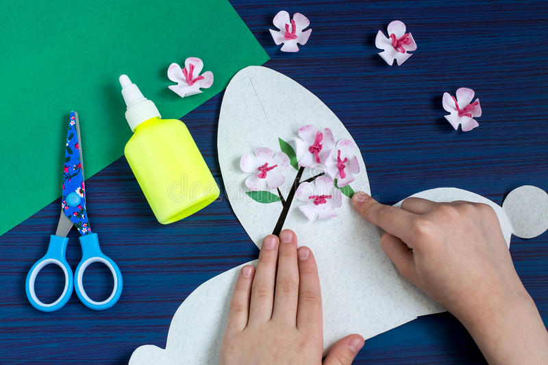 Making gift box by the child for Mother`s Day. Step 9. Making gift box by the child for Mother`s Day. Children`s art project. DIY concept. Step-by-step photo stock images