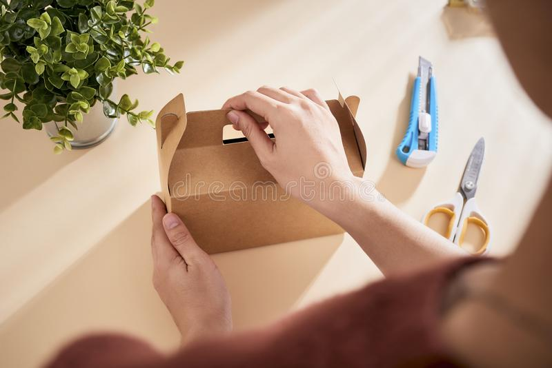 Making a gift box. DIY concept. Step-by-step photo instruction.  royalty free stock images