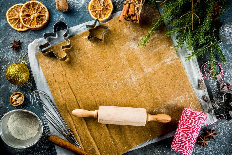 Making gingerbread cookie. Christmas traditions homemade baking Cooking gingerbread star cookies, gingerbread men, flat lay, top view, with accessories royalty free stock images