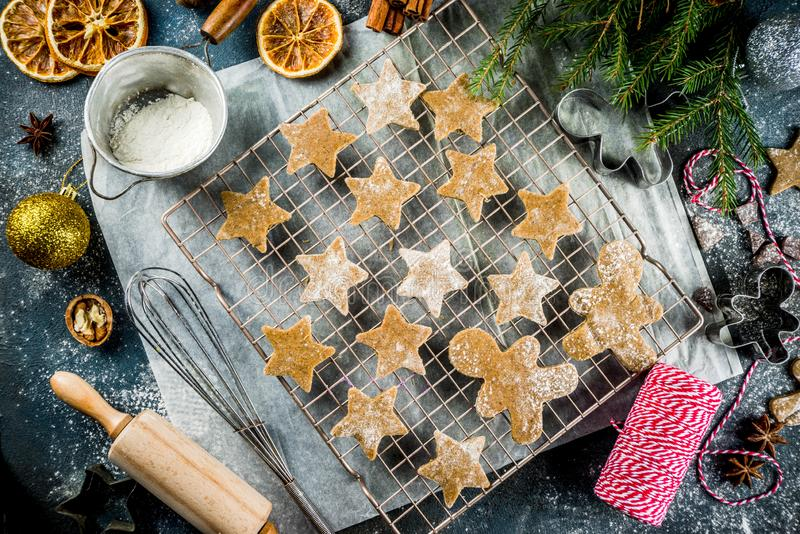 Making gingerbread cookie. Christmas traditions homemade baking Cooking gingerbread star cookies, gingerbread men, flat lay, top view, with accessories stock image