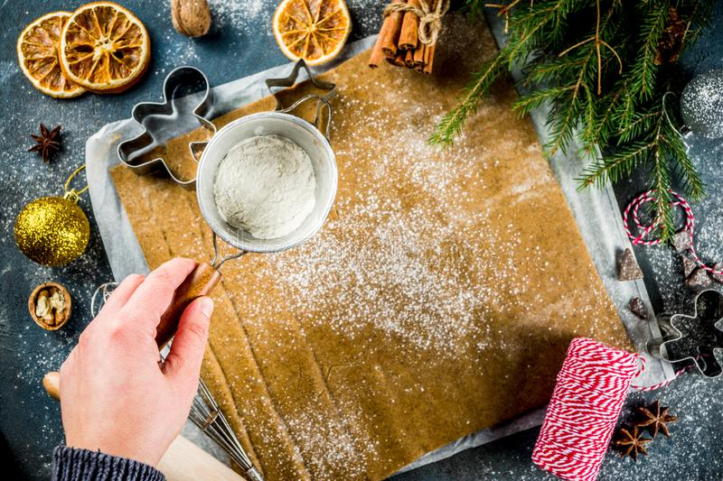 Making gingerbread cookie. Girl cooking christmas homemade gingerbread star cookies, gingerbread men, flat lay, top view, with accessories ingredients for baking stock photos