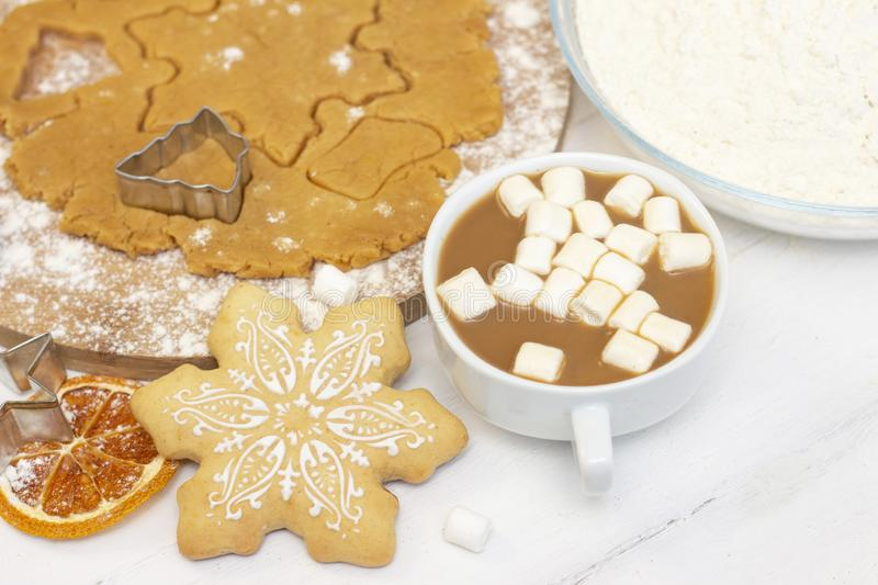Making gingerbread cookies. Christmas baking background dough and cookies, coffee with milk. And marshmallows stock image