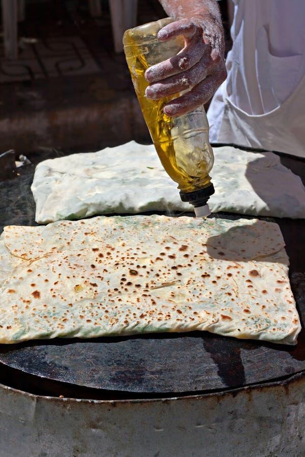 Making gozleme on turkish market royalty free stock photos