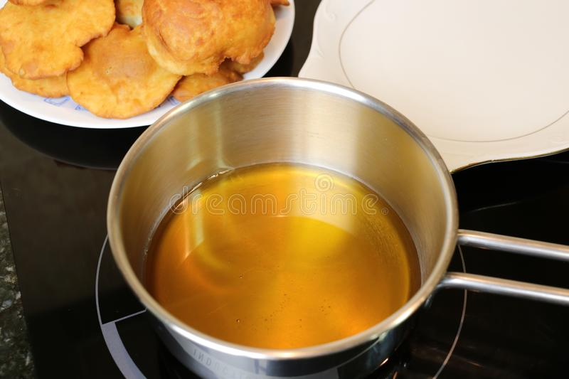Making grandmother`s cakes a homemade sweet fried with honey stock image