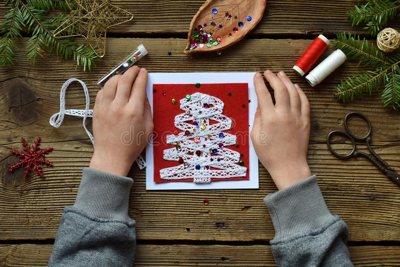 Making of handmade christmas greeting card from felt with your own hands. Children& x27;s DIY concept. Making xmas decoration stock photos
