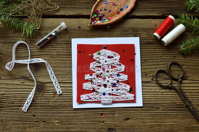 Making of handmade christmas greeting card from felt with your own hands. Children& x27;s DIY concept. Making xmas decoration. Crafts gift art tree holiday new royalty free stock photography